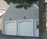 1st Metropolitan Home Improvement - Garage Doors